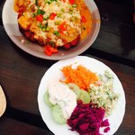 Selection of mixed salads and potato pancake with goulash on top - very tasty and great value!