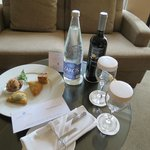 Welcome letter, complimentary Cretan hors d'oeuvres, wine and water