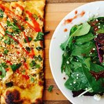 Thai pizza with a gourmet side salad
