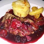 Magret of duck with berry sauce and dauphinoise potatoes