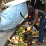 Local selling fresh coconuts.