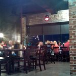 Exposed brick throughout the restaurant - a one time Ford dealership damaged in 2011 tornado and