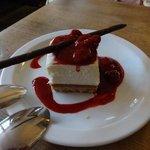 white chocolate cheesecake w/raspberry couli