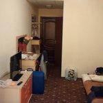 Towards the room's door