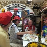 Ending the tour with some wonderful Paella; note the fetching caps we were given as part of the