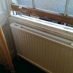 Wooden windows in poor repair.