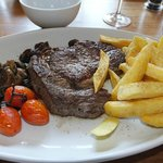 Rib eye steak, cherry tomatoes and hand cut chips