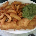 Battered medium sized haddock,chips and mushy peas.