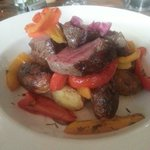 Bramsche Todmorden.  Venison haunch steak on a bed of sweet and sour peppers and roast baby pota
