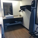 Modern sink and good ironing board and iron room 336