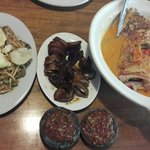 Karedok, grilled squid, sea bass head curry, and chili. Great food, great taste.
