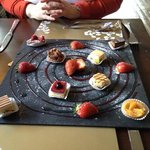 seven flavours of petit fours with raspberry and champagne coulis