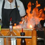 Flambéed steak at the table