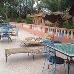 Sunbeds round pool