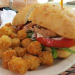 Salmon sandwich and tots