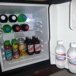 Stocked refrigerator in concierge room