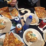 Selection of different pizzas and drinks and sides