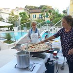 Marina and her mom making paella