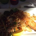 Panfried Atlantic Salmon served with a soba noodle, capsicum, red onion, cucumber and green sal