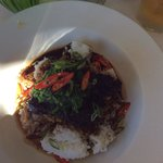 Asian style braised beef cheek with sticky rice topped with wakame salad