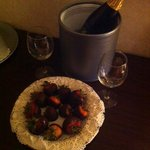 Delicious bluberry champagne and chocolaye covered strawberries