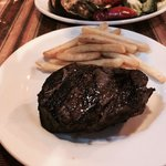Filet with fries. Perfectly cooked. They claim it was 8 oz, but much bigger.
