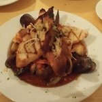 Cioppino of Northwest Seafood Fresh Scallops, Salmon, Prawns, Clams, Mussels, Dungeness Crab, a