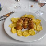 Calamari gratinati al forno con patate