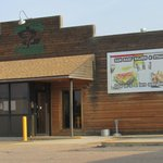 Sam Bass Saloon & Steakhouse on south side of truck stop