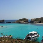 The Blue Lagoon in Comino which must be visited by taking a day cruise excursion!!