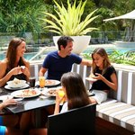 Enjoy a wood-fired pizza on the bar terrace