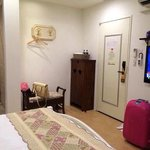 Very clean room with big TV,1.5hp aircon, shoes rack, & small fridge.