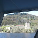 View of Urquhart castle from the inside of the boat