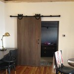 Cool door in hotel suite, into massive closet.