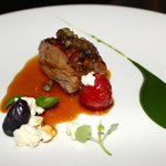 Slow cooked neck of lamb - basil emulsion - confit tomato - feta - spring salad