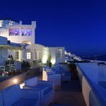 Front deck of hotel looking toard Fira just after sunset