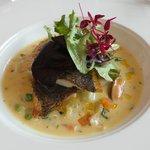 Main: Pan-seared fillet of sea bream, carrot, leek, potato & mussel broth, watercress, lemon oil