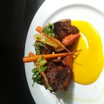 Marinated Kangeroo rump with roasted baby vegetables and a carrot and cumin emulsion