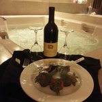 Romantic Package: Came with Champagne and Chocolate Covered Strawberries (deals may vary)
