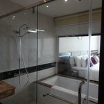 Separate shower and tub. Slick floor but great water pressure!