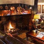 Sit by our roaring fire
