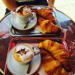 Breakfast: two croissants and cappuccino = 6.5€