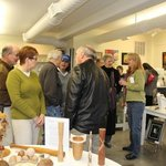 Crowd gathers for gallery opening -- exhibits held throughout the year