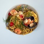 "Spaghetti with Mediterranean ""fruits de mer"", cherry tomatoes and lobster bisque"