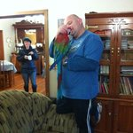Chris and his parrot!  Charming, the two of them.