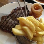 Scotch sirloin steak with chips and onion rings