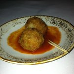 Complimentary fried risotto balls in tomato sauce