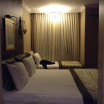 hotel room with 3 beds