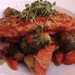 SALMON AL PISTACCHIO $29 Dijon and pistachio-crusted Scottish salmon, brussels sprouts, artichok