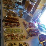 The fab selection of cakes, pastries and crepes for breakfast
